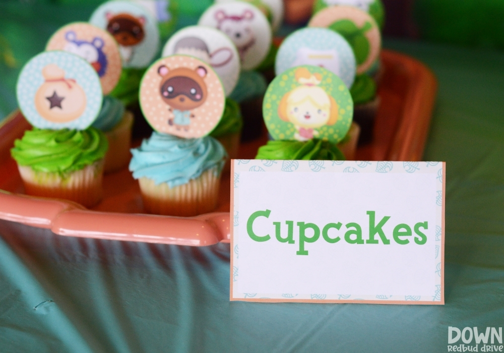 Closeup of the cupcakes food card for the Animal Crossing birthday party.