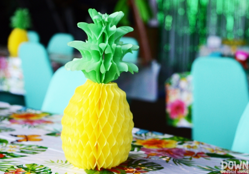 Close up of the pineapple table centerpieces.