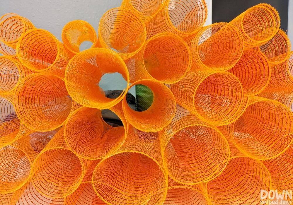 Orange deco mesh cut to size for the mesh pumpkin wreath.
