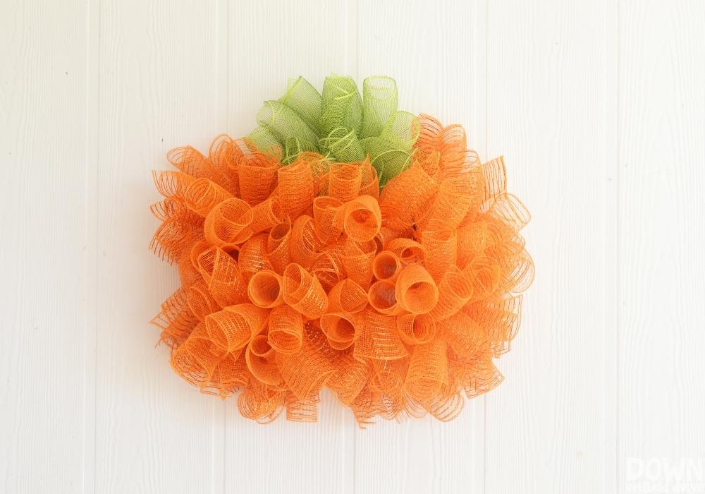 The finished DIY Mesh Pumpkin Wreath.