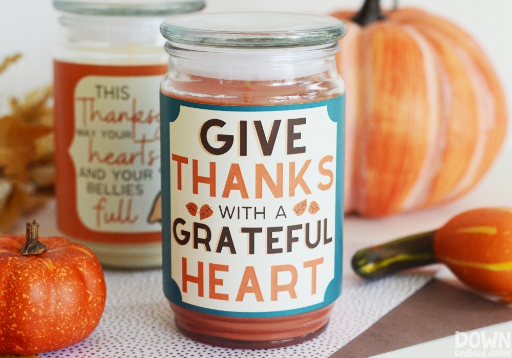 """Closeup of a finished DIY Thanksgiving Candle that says """"Give thanks with a grateful heart""""."""