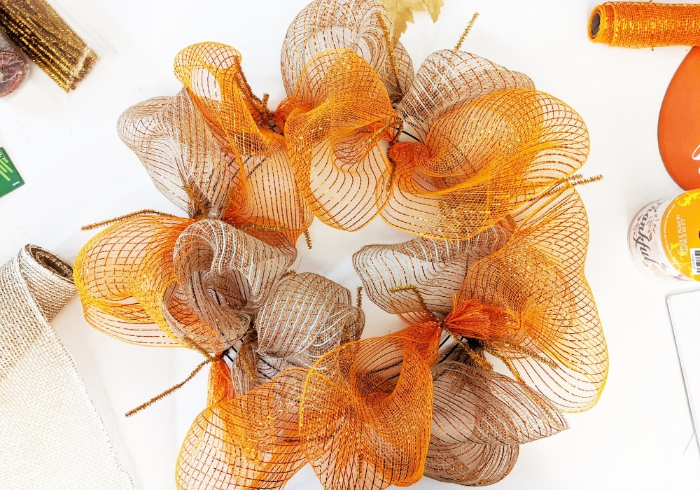 Fall colored deco mesh attached to a wreath form for the DIY Thanksgiving Mesh Wreath.