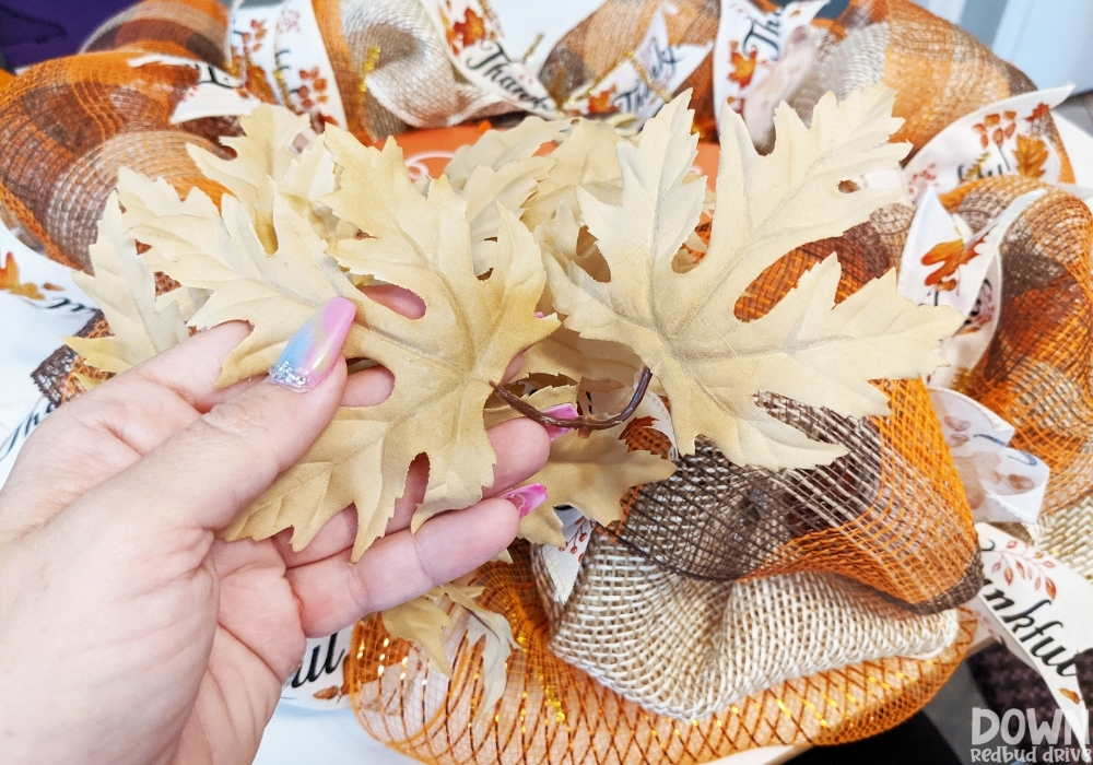 Closeup of plastic floral leaves for the fall deco mesh wreath DIY.