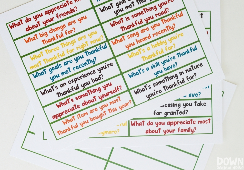 Overhead view of the thanksgiving conversation starters printables.