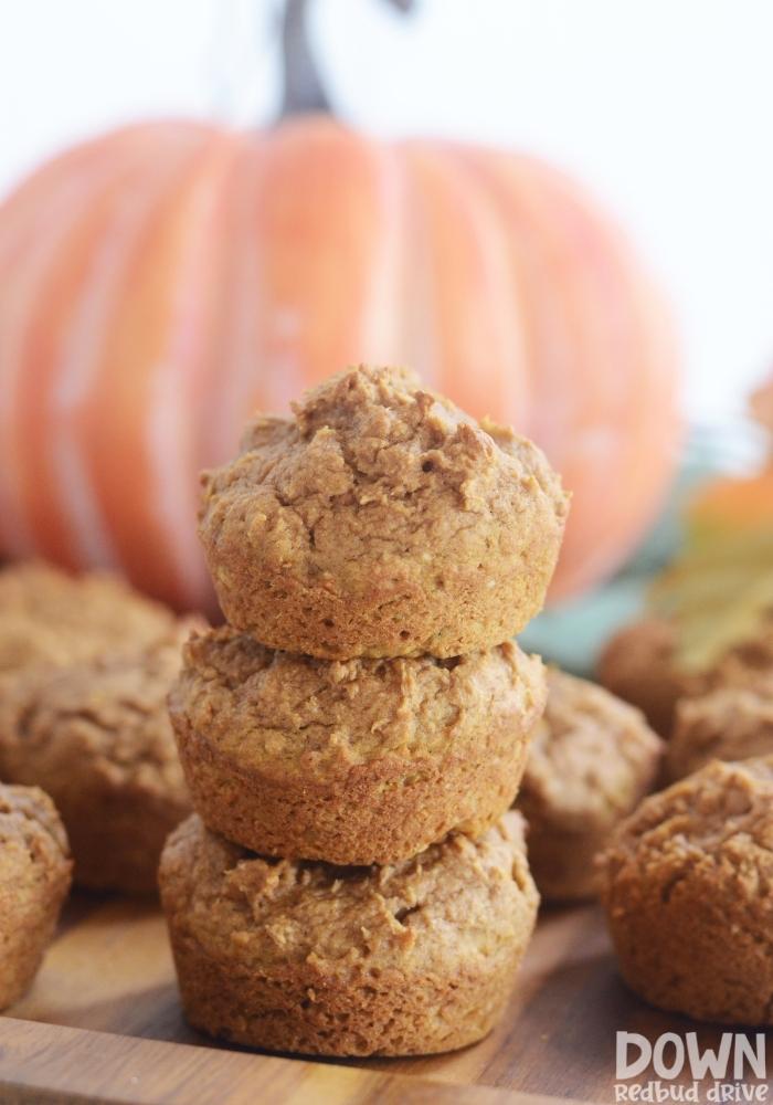 A tall closeup of the finished pumpkin muffins.