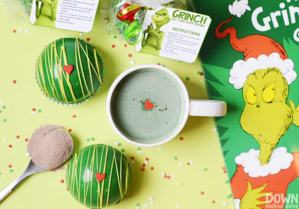 Overhead view of a cup of hot cocoa made with a Grinch Hot Chocolate Bomb.